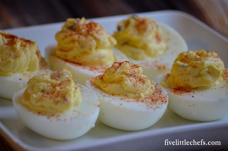Bacon Deviled Eggs is a twist to the classic. This easy recipe adds in bacon, hot sauce and jack cheese. These will go fast so make sure you make enough for a crowd!