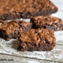 Easy Chocolate Pecan Brownie recipe made from a boxed mix and then taken to a new level with chocolate chips, coconut and pecans.
