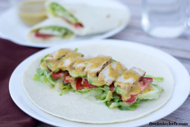 Honey Mustard Chicken Wrap is a fast and easy recipe when you are using leftover Honey Mustard Grilled Chicken. This is great for lunch, dinner or on the go! It is packed with a variety of vegetables to give texture to each bite. fivelittlechefs.com